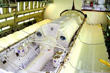 KENNEDY SPACE CENTER, FLA. -- The STS-90 Neurolab payload and four Getaway Specials (GAS) await payload bay door closure in the orbiter Columbia today in Orbiter Processing Facility bay 3. Investigations during the Neurolab mission will focus on the effects of microgravity on the nervous system. Specifically, experiments will study the adaptation of the vestibular system, the central nervous system, and the pathways that control the ability to sense location in the absence of gravity, as well as the effect of microgravity on a developing nervous system. The crew of STS-90, slated for launch in April, will include Commander Richard Searfoss, Pilot Scott Altman, Mission Specialists Richard Linnehan, Dafydd (Dave) Williams, M.D., and Kathryn (Kay) Hire, and Payload Specialists Jay Buckey, M.D., and James Pawelczyk, Ph.D