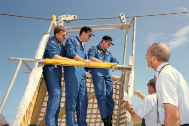 STS-90 Mission Specialist Dafydd (Dave) Williams, M.D., with the Canadian Space Agency, Pilot Scott Altman, and Payload Specialist Jay Buckey, M.D., train in an emergency egress system slidewire basket at Launch Pad 39B during Terminal Countdown Demonstration Test (TCDT) activities. The TCDT is held at KSC prior to each Space Shuttle flight to provide crews with the opportunity to participate in simulated countdown activities. Columbia is targeted for launch of STS-90 on April 16 at 2:19 p.m. EDT and will be the second mission of 1998. The mission is scheduled to last nearly 17 days