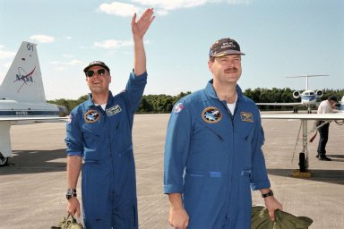 KENNEDY SPACE CENTER, FLA. -- STS-90 Payload Specialist Jay Buckey, M.D. (at left), and Pilot Scott Altman arrive at Kennedy Space Center's Shuttle Landing Facility in preparation for the launch of Columbia on April 16 at 2:19 p.m. EDT from KSC's Launch Pad 39B. The launch of Neurolab on STS-90, which will be the second mission of 1998, is scheduled to last nearly 17 days