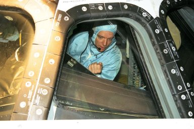 STS-91 Commander Charles Precourt inspects the windows of the cockpit from inside of the orbiter Discovery during the Crew Equipment Interface Test, or CEIT, in KSC's Orbiter Processing Facility Bay 2. During CEIT, the crew have an opportunity to get a hands-on look at the payloads with which they'll be working on-orbit. The STS-91 crew are scheduled to launch aboard the Shuttle Discovery for the ninth and final docking with the Russian Space Station Mir from KSC's Launch Pad 39A on May 28 at 8:05 EDT