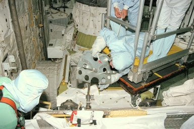 STS-91 crew members participate in the Crew Equipment Interface Test, or CEIT, in KSC's Orbiter Processing Facility Bay 2. Here, Mission Specialist Janet Kavandi, Ph.D., inspects a foot restraint for an external vehicular activity (EVA) spacewalk. During CEIT, the crew have an opportunity to get a hands-on look at the payloads and equipment with which they'll be working on-orbit. The STS-91 crew are scheduled to launch aboard the Shuttle Discovery for the ninth and final docking with the Russian Space Station Mir from KSC's Launch Pad 39A on May 28 at 8:05 EDT