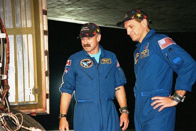 STS-90 Mission Specialists Dafydd (Dave) Williams, M.D., with the Canadian Space Agency (left) and Richard Linnehan, D.V.M., inspect the orbiter Columbia's tires in the evening after their midday arrival on May 3, ending their nearly 16-day Neurolab mission. The 90th Shuttle mission was Columbia's 13th landing at the space center and the 43rd KSC landing in the history of the Space Shuttle program. During the mission, the crew conducted research to contribute to a better understanding of the human nervous system