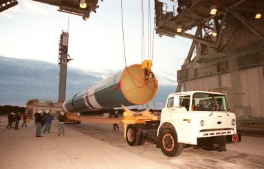 The first stage of a Boeing Delta II rocket is raised off a truck bed before being lifted into place on the tower at Launch Complex 17, Cape Canaveral Air Station. The rocket will carry the Stardust spacecraft into space for a close encounter with the comet Wild 2 in January 2004. Using a medium called aerogel, it will capture comet particles flying off the nucleus of the comet, plus collect interstellar dust for later analysis. The collected samples will return to Earth in a Sample Return Capsule to be jettisoned as Stardust swings by Earth in January 2006. Stardust is scheduled to be launched on Feb. 6, 1999
