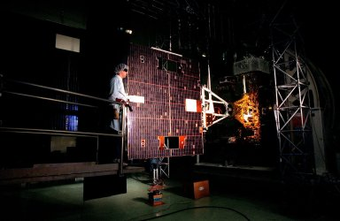 A Loral worker at Astrotech, Titusville, Fla., assists with an illumination test for circuitry verification on the solar panel of the GOES-L [ http://www-pao.ksc.nasa.gov/kscpao/captions/subjects/goes-l.htm ] weather satellite. The satellite is to be launched from Cape Canaveral Air Station aboard an Atlas II rocket in late March. The GOES-L is the fourth of a new advanced series of geostationary weather satellites for the National Oceanic and Atmospheric Administration. It is a three-axis inertially stabilized spacecraft that will provide pictures and perform atmospheric sounding at the same time. Once launched, the satellite, to be designated GOES-11, will undergo checkout and provide backup capabilities for the existing, aging GOES East weather satellite