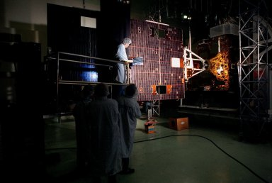 Loral workers at Astrotech, Titusville, Fla., perform an illumination test for circuitry verification on the solar panel of the GOES-L [ http://www-pao.ksc.nasa.gov/kscpao/captions/subjects/goes-l.htm ] weather satellite. The satellite is to be launched from Cape Canaveral Air Station aboard an Atlas II rocket in late March. The GOES-L is the fourth of a new advanced series of geostationary weather satellites for the National Oceanic and Atmospheric Administration. It is a three-axis inertially stabilized spacecraft that will provide pictures and perform atmospheric sounding at the same time. Once launched, the satellite, to be designated GOES-11, will undergo checkout and provide backup capabilities for the existing, aging GOES East weather satellite
