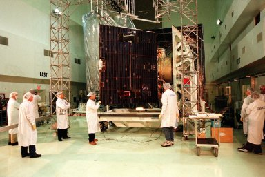 Loral workers at Astrotech, Titusville, Fla., deploy one of the solar panels of the GOES-L [ http://www-pao.ksc.nasa.gov/kscpao/captions/subjects/goes-l.htm ] weather satellite, to be launched from Cape Canaveral Air Station (CCAS) aboard an Atlas II rocket in late March. The GOES-L is the fourth of a new advanced series of geostationary weather satellites for the National Oceanic and Atmospheric Administration. It is a three-axis inertially stabilized spacecraft that will provide pictures and perform atmospheric sounding at the same time. Once launched, the satellite, to be designated GOES-11, will undergo checkout and provide backup capabilities for the existing, aging GOES East weather satellite