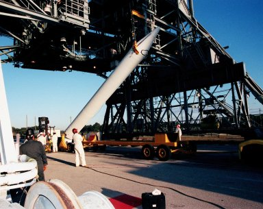 A fourth and final Solid Rocket Booster arrives at Pad 17A, Cape Canaveral Air Station to be mated with a Boeing Delta II rocket. The rocket will carry the Stardust satellite into space for a close encounter with the comet Wild 2 in January 2004. Using a medium called aerogel, Stardust will capture comet particles flying off the nucleus of the comet, plus collect interstellar dust for later analysis. The collected samples will return to Earth in a Sample Return Capsule to be jettisoned as Stardust swings by Earth in January 2006. Stardust is scheduled to be launched on Feb. 6, 1999