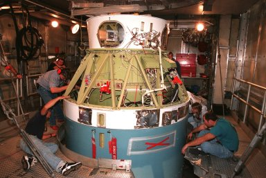 Workers at Pad 17A, Cape Canaveral Air Station, ensure the successful mating of the second stage of a Boeing Delta II rocket with the first stage below it. The rocket is targeted for launch on Feb. 6, carrying the Stardust [ http://www-pao.ksc.nasa.gov/kscpao/captions/subjects/stardust.htm ] spacecraft into space for a close encounter with the comet Wild 2 in January 2004. Using a substance called aerogel, Stardust will capture comet particles flying off the nucleus of the comet, plus collect interstellar dust for later analysis. The collected samples will return to Earth in a sample return capsule to be jettisoned as Stardust swings by Earth in January 2006