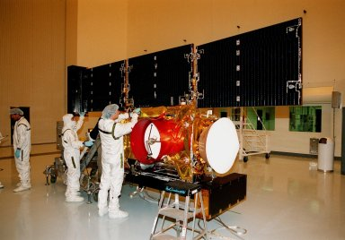 In the Payload Hazardous Servicing Facility, workers adjust the solar panels of the Stardust [ http://www-pao.ksc.nasa.gov/kscpao/captions/subjects/stardust.htm ]spacecraft before performing lighting tests. Stardust is scheduled to be launched aboard a Boeing Delta II rocket from Launch Pad 17A, Cape Canaveral Air Station, on Feb. 6, 1999, for a rendezvous with the comet Wild 2 in January 2004. Stardust will use a substance called aerogel to capture comet particles flying off the nucleus of the comet, plus collect interstellar dust for later analysis. The collected samples will return to Earth in a sample return capsule to be jettisoned as it swings by Earth in January 2006
