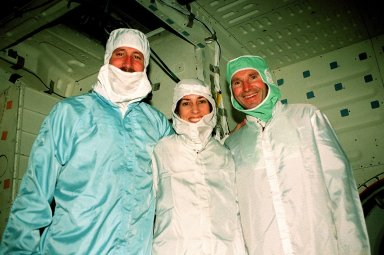 In the Orbiter Processing Facility bay 1, STS-96 Commander Kent V. Rominger and Mission Specialists Ellen Ochoa (Ph.D.) and Valery Ivanovich Tokarev pose inside the orbiter Discovery. The STS-96 crew is at KSC to take part in a Crew Equipment Interface Test. Other members participating are Pilot Rick Douglas Husband and Mission Specialists Tamara E. Jernigan (Ph.D.), Daniel Barry (M.D., Ph.D.) and Julie Payette, who is with the Canadian Space Agency. Tokarev represents the Russian Space Agency. The primary payload of STS-96 is the SPACEHAB Double Module. In addition, the Space Shuttle will carry unpressurized cargo such as the external Russian cargo crane known as STRELA; the Spacehab Oceaneering Space System Box (SHOSS), which is a logistics items carrier; and an ORU Transfer Device (OTD), a U.S.-built crane that will be stowed on the station for use during future ISS assembly missions. These cargo items will be stowed on the International Cargo Carrier, fitted inside the payload bay behind the SPACEHAB module. STS-96 is targeted for launch on May 24 from Launch Pad 39B