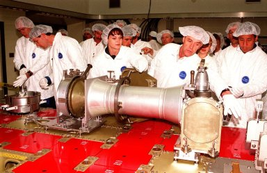At Astrotech in Titusville, Fla., members of two Shuttle crews get a close look at components of a Russian cargo crane, the Strela, to be mounted to the exterior of the Russian station segment on the International Space Station (ISS). At left are STS-96 Mission Specialist Daniel T. Barry and Pilot Rick Douglas Husband. At center, STS-96 Mission Specialist Tamara E. Jernigan gives her attention to a technician with DaimlerChrysler while STS-101 Mission Specialist Edward Tsang Lu looks on. Both missions include the SPACEHAB Double Module, carrying internal and resupply cargo for Station outfitting. For the first time, STS-96 will include an Integrated Cargo Carrier (ICC) that will carry the Strela; the SPACEHAB Oceaneering Space System Box (SHOSS), which is a logistics items carrier; and a U.S.-built crane (ORU Transfer Device, or OTD) that will be stowed on the station for use during future ISS assembly missions. The ICC can carry up to 6,000 lb of unpressurized payload. It was built for SPACEHAB by DaimlerChrysler and RSC Energia of Korolev, Russia. STS-96 is targeted for launch on May 24 from Launch Pad 39B. STS-101 is scheduled to launch in early December 1999