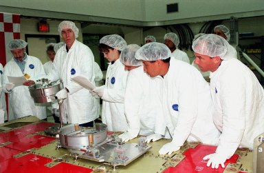 Two Shuttle crews take part in familiarization activities at Astrotech in Titusville, Fla. From left are STS-96 Mission Specialists Daniel T. Barry and Tamara E. Jernigan, and Pilot Rick Douglas Husband; plus STS-101 Mission Specialists Edward Tsang Lu and Jeffrey N. Williams. They are looking at components of a Russian cargo crane, the Strela, to be mounted to the exterior of the Russian station segment on the International Space Station (ISS). Both missions include the SPACEHAB Double Module, carrying internal and resupply cargo for Station outfitting. For the first time, STS-96 will include an Integrated Cargo Carrier (ICC) that will carry the Strela; the SPACEHAB Oceaneering Space System Box (SHOSS), which is a logistics items carrier; and a U.S.-built crane (ORU Transfer Device, or OTD) that will be stowed on the station for use during future ISS assembly missions. The ICC can carry up to 6,000 lb of unpressurized payload. It was built for SPACEHAB by DaimlerChrysler Aerospace of Bremen and RSC Energia of Korolev, Russia. STS-96 is targeted for launch on May 24 from Launch Pad 39B. STS-101 is scheduled to launch in early December 1999