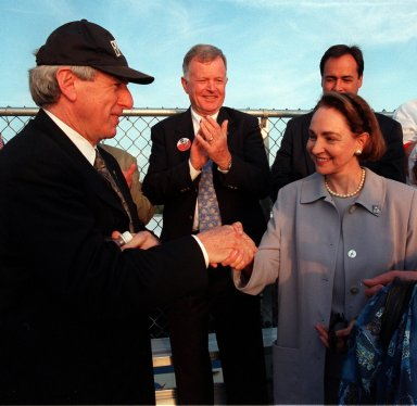 NASA Administrator Daniel Goldin (left) greets Mme. Aline Chretien, wife of the Canadian Prime Minister, at the launch of STS-96. Looking on in the background (between them) is former astronaut Jean-Loup Chretien (no relation), who flew on STS-86. Mme. Chretien attended the launch because one of the STs-96 crew is Mission Specialist Julie Payette, who represents the Canadian Space Agency. Space Shuttle Discovery launched on time at 6:49:42 a.m. EDT to begin a 10-day logistics and resupply mission for the International Space Station. Along with such payloads as a Russian crane, the Strela; a U.S.-built crane; the Spacehab Oceaneering Space System Box (SHOSS), a logistics items carrier; and STARSHINE, a student-involved experiment, Discovery carries about 4,000 pounds of supplies, to be stored aboard the station for use by future crews, including laptop computers, cameras, tools, spare parts, and clothing. The mission includes a space walk to attach the cranes to the outside of the ISS for use in future construction. Landing is expected at the SLF on June 6 about 1:58 a.m. EDT
