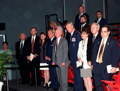 At a special presentation in the IMAX 2 Theater in the Kennedy Space Center Visitor Complex, the Hammer Award is presented to Kennedy Space Center and the 45th Space Wing. Among the attendees in the audience are (center) Center Director Roy D. Bridges Jr., flanked by (at left) Commander of the 45th Space Wing Brig. Gen. F. Randall Starbuck and (at right) Commander of the Air Force Space Command General Richard B. Myers. Standing second from right is NASA Administrator Daniel S. Goldin. At the far right is Morley Winograd, director of the National Partnership for Reinventing Government, who presented the award. The Hammer Award is Vice President Al Gore's special recognition of teams of federal employees who have made significant contributions in support of the principles of the National Partnership for Reinventing Government. This Hammer Award acknowledges the accomplishments of a joint NASA and Air Force team that established the Joint Base Operations and Support Contract (J-BOSC) Source Evaluation Board (SEB). Ed Gormel and Chris Fairey, co-chairs of the SEB, accepted the awards for the SEB. The team developed and implemented the acquisition strategy for establishing a single set of base operations and support service requirements for KSC, Cape Canaveral Air Station and Patrick Air Force Base
