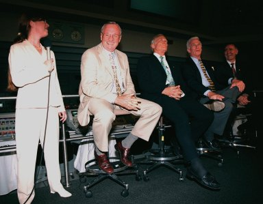 """KENNEDY SPACE CENTER, FLA. -- In the Apollo/Saturn V Center, Lisa Malone (left), chief of KSC's Media Services branch, laughs at a humorous comment along with former Apollo astronauts Neil A. Armstrong and Edwin """"Buzz"""" Aldrin who flew on Apollo 11, the launch to the moon; Gene Cernan, who flew on Apollo 10 and 17; and Walt Cunningham, who flew on Apollo 7. The four met with the media before an anniversary banquet celebrating the accomplishments of the Apollo program team. This is the 30th anniversary of the launch and moon landing, July 16 and July 20, 1969. Neil Armstrong was the first man to set foot on the moon"""