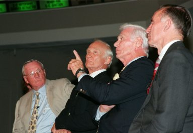 """KENNEDY SPACE CENTER, FLA. -- At a media conference in the Apollo/Saturn V Center, former Apollo astronaut Gene Cernan, who flew on Apollo 10 and 17, makes a point in a comment for the press. Joining him in the conference are other Apollo astronauts (left) Neil A. Armstrong and Edwin """"Buzz"""" Aldrin, who both flew on Apollo 11, the launch to the moon; and (right) Walt Cunningham, who flew on Apollo 7. The four astronauts were at KSC for the 30th anniversary of the Apollo 11 launch and moon landing, July 16 and July 20, 1969. Neil Armstrong was the first man to set foot on the moon"""