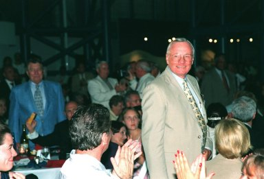 """KENNEDY SPACE CENTER, FLA. -- Former Apollo 11 astronaut Neil A. Armstrong stands to a round of applause after being introduced at the anniversary banquet honoring the Apollo team, the people who made the entire lunar landing program possible. The banquet was held in the Apollo/Saturn V Center, part of the KSC Visitor Complex. This is the 30th anniversary of the Apollo 11 launch and moon landing, July 16 and July 20, 1969. Neil Armstrong was the first man to set foot on the moon. He appeared at the banquet with other former astronauts Edwin """"Buzz"""" Aldrin, Gene Cernan, Walt Cunningham and others"""