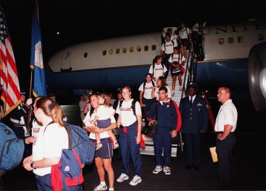 KENNEDY SPACE CENTER, FLA. -- Members of the U.S. Women's World Cup Soccer Team are greeted by NASA Administrator Daniel S. Goldin as they disembark from a plane at the Skid Strip at Cape Canaveral Air Station. They arrived with First Lady Hillary Rodham Clinton to view the launch of Space Shuttle mission STS-93 scheduled for 12:36 a.m. EDT July 20. Much attention has been generated over the launch due to Commander Eileen M. Collins, the first woman to serve as commander of a Shuttle mission. The primary payload of the five-day mission is the release of the Chandra X-ray Observatory, which will allow scientists from around the world to study some of the most distant, powerful and dynamic objects in the universe