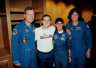 A member of the U.S. Women's World Cup Soccer Team poses with Astronauts (from left) Steven W. Lindsey, Nancy Jane Currie and Laurel B. Clark. The team arrived at the Skid Strip at Cape Canaveral Air Station with First Lady Hillary Rodham Clinton to view the launch of Space Shuttle mission STS-93. Liftoff is scheduled for 12:36 a.m. EDT July 20. Much attention has been generated over the launch due to Commander Eileen M. Collins, the first woman to serve as commander of a Shuttle mission. The primary payload of the five-day mission is the Chandra X-ray Observatory, which will allow scientists from around the world to study some of the most distant, powerful and dynamic objects in the universe. The new telescope is 20 to 50 times more sensitive than any previous X-ray telescope and is expected to unlock the secrets of supernovae, quasars and black holes