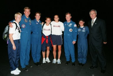 Members of the U.S. World Cup Soccer Team pose with Astronauts Scott Parazynski, Heidemarie M. Stefanyshyn-Piper, Steven W. Lindsey, and Nancy Jane Currie and NASA Administrator Daniel Goldin after the team's arrival at the Skid Strip at Cape Canaveral Air Station. The team arrived with First Lady Hillary Rodham Clinton to view the launch of Space Shuttle mission STS-93. Liftoff is scheduled for 12:36 a.m. EDT July 20. Much attention has been generated over the launch due to Commander Eileen M. Collins, the first woman to serve as commander of a Shuttle mission. The primary payload of the five-day mission is the Chandra X-ray Observatory, which will allow scientists from around the world to study some of the most distant, powerful and dynamic objects in the universe. The new telescope is 20 to 50 times more sensitive than any previous X-ray telescope and is expected to unlock the secrets of supernovae, quasars and black holes