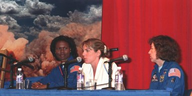"KENNEDY SPACE CENTER, FLA. -- Astronaut Yvonne Cagle (left); Jennifer Harris (center); the Mars 2001 Operations System Development Manager at the Jet Propulsion Laboratory; and Astronaut Ellen Ochoa (right) participate in a panel about ""Past, Present and Future of Space,"" held at a women's forum in the Apollo/Saturn V Center. The forum included a welcome by Center Director Roy Bridges and remarks by Donna Shalala, secretary of Department of Health and Human Services. The attendees are planning to view the launch of STS-93 at the Banana Creek viewing site. Much attention has been generated over the launch due to Commander Eileen M. Collins, the first woman to serve as commander of a Shuttle mission. The primary payload of the five-day mission is the Chandra X-ray Observatory, which will allow scientists from around the world to study some of the most distant, powerful and dynamic objects in the universe. Liftoff is scheduled for July 20 at 12:36 a.m. EDT"