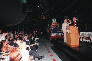 """KENNEDY SPACE CENTER, FLA. -- Former Apollo astronauts Neil Armstrong (left) and Gene Cernan entertain the audience during an anniversary banquet honoring the Apollo program team, the people who made the entire lunar landing program possible. The banquet was held in the Apollo/Saturn V Center, part of the KSC Visitor Complex. This is the 30th anniversary of the Apollo 11 launch and moon landing, July 16 and July 20, 1969. Other guests at the banquet were astronauts Wally Schirra, Edwin """"Buzz"""" Aldrin and Walt Cunningham. Armstrong was the first man to walk on the moon; Cernan was the last"""