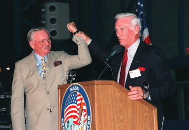 """KENNEDY SPACE CENTER, FLA. -- Former Apollo astronauts Neil Armstrong (left) and Gene Cernan entertain the audience during an anniversary banquet honoring the Apollo program team, the people who made the entire lunar landing program possible. The banquet was held in the Apollo/Saturn V Center, part of the KSC Visitor Complex. This is the 30th anniversary of the Apollo 11 launch and moon landing, July 16 and July 20, 1969. Other guests at the banquet were astronauts Wally Schirra, Edwin """"Buzz"""" Aldrin and Walt Cunningham. Neil Armstrong was the first man to walk on the moon; Gene Cernan was the last"""