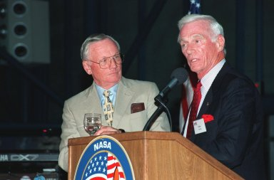 """KENNEDY SPACE CENTER, FLA. -- During an anniversary banquet honoring the Apollo program team, the people who made the entire lunar landing program possible, former Apollo astronauts Neil Armstrong (left) and Gene Cernan talk about their experiences. The banquet was held in the Apollo/Saturn V Center, part of the KSC Visitor Complex. This is the 30th anniversary of the Apollo 11 launch and moon landing, July 16 and July 20, 1969. Other guests at the banquet were astronauts Wally Schirra, Edwin """"Buzz"""" Aldrin and Walt Cunningham. Neil Armstrong was the first man to walk on the moon; Gene Cernan was the last"""
