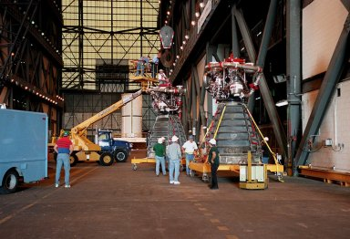 KENNEDY SPACE CENTER, FLA. -- Workers in the Vehicle Assembly Building move orbiter Endeavour's main engine No. 3 (in front) out of the way before moving the replacement engine into place. Following routine testing procedures on a separate test engine, analysis revealed delamination on the wall of the engine's main combustion chamber. When data revealed that one of Endeavour's engines had undergone similar testing procedures, managers opted to replace the suspect engine as a precaution. Space Shuttle Endeavour is targeted for launch on mission STS-99 on Jan. 13, 2000, at 1:11 p.m. EST. STS-99 is the Shuttle Radar Topography Mission