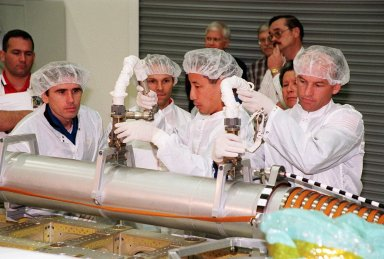 KENNEDY SPACE CENTER, FLA. -- During a Crew Equipment Interface Test (CEIT) at SPACEHAB, in Cape Canaveral, Fla., members of the STS-101 crew learn how to manipulate the Russian crane Strela. At left is Yuri Malenchenko, who is with the Russian Space Agency (RSA); in the center is Edward Tsang Lu (Ph.D.); at right is Mission Specialist Jeffrey N. Williams. Other crew members are Commander James Donald Halsell Jr., Pilot Scott Horowitz, and Mission Specialists Mary Ellen Weber, (Ph.D.) and Boris W. Morukov (RSA). The primary objective of the STS-101 mission is to complete the initial outfitting of the International Space Station, making it fully ready for the first long-term crew. The seven-member crew will transfer almost two tons of equipment and supplies from SPACEHAB's Logistics Double Module. Additionally, they will unpack a shipment of supplies delivered earlier by a Russian Progress space tug and begin outfitting the newly arrived Zvezda Service Module. Three astronauts will perform two space walks to transfer and install parts of the Russian Strela cargo boom that are attached to SPACEHAB's Integrated Cargo Container, connect utility cables between Zarya and Zvezda, and install a magnetometer/pole assembly on the Service Module. Additional activities for the STS-101 astronauts include working with the Space Experiment Module (SEM-06) and the Mission to America's Remarkable Schools (MARS), two educational initiatives. STS-101 is scheduled for launch no earlier than March 16, 2000
