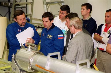 During a Crew Equipment Interface Test (CEIT), members of the STS-101 crew learn about some of the cargo that will be on their mission from workers at SPACEHAB, in Cape Canaveral, Fla. At left are Mission Specialists Boris W. Morukov and Yuri Malenchenko, who are with the Russian Space Agency. Other crew members are Commander James Donald Halsell Jr., Pilot Scott Horowitz, and Mission Specialists Mary Ellen Weber (Ph.D.), Edward Lu, and Jeffrey N. Williams, The primary objective of the STS-101 mission is to complete the initial outfitting of the International Space Station, making it fully ready for the first long-term crew. The seven-member crew will transfer almost two tons of equipment and supplies from SPACEHAB's Logistics Double Module. Additionally, they will unpack a shipment of supplies delivered earlier by a Russian Progress space tug and begin outfitting the newly arrived Zvezda Service Module. Three astronauts will perform two space walks to transfer and install parts of the Russian Strela cargo boom that are attached to SPACEHAB's Integrated Cargo Container, connect utility cables between Zarya and Zvezda, and install a magnetometer/pole assembly on the Service Module. Additional activities for the STS-101 astronauts include working with the Space Experiment Module (SEM-06) and the Mission to America's Remarkable Schools (MARS), two educational initiatives. STS-101 is scheduled for launch no earlier than March 16, 2000
