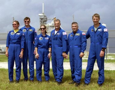 KENNEDY SPACE CENTER, FLA. - Members of the STS-112 crew pose in front of Launch Pad 39B during a tour of Kennedy Space Center prior to launch. From left, they are Mission Specialist Sandra H. Magnus, Commander Jeffrey S. Ashby, Pilot Pamela Ann Melroy, and Mission Specialists David A. Wolf, Fyodor N. Yurchikhin of the Russian Space Agency, and Piers J. Sellers. The launch of Space Shuttle Atlantis was postponed today to no earlier than Thursday, Oct. 3, while weather forecasters and the mission management team assess the possible effect Hurricane Lili may have on the Mission Control Center located at the Lyndon B. Johnson Space Center in Houston, Texas.