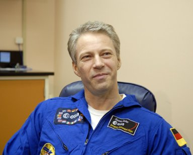 KENNEDY SPACE CENTER, FLA. -- European Space Agency astronaut Thomas Reiter, returning from a 6-month stay on the International Space Station, relaxes in the crew quarters at Kennedy Space Center. Reiter returned to Earth with the STS-116 crew aboard Space Shuttle Discovery. Landing took place on Runway 15 at NASA Kennedy Space Center's Shuttle Landing Facility as the sun set on the shortest day of the year. During the STS-116 mission, three spacewalks attached the P5 integrated truss structure to the station, and completed the rewiring of the orbiting laboratory's power system. A fourth spacewalk retracted a stubborn solar array. Main gear touchdown was at 5:32 p.m. EST. Nose gear touchdown was at 5:32:12 p.m. and wheel stop was at 5:32:52 p.m. At touchdown -- nominally about 2,500 ft. beyond the runway threshold -- the orbiter is traveling at a speed ranging from 213 to 226 mph. Discovery traveled 5,330,000 miles, landing on orbit 204. Mission elapsed time was 12 days, 20 hours, 44 minutes and 16 seconds. This is the 64th landing at KSC. Photo credit: NASA/Kim Shiflett