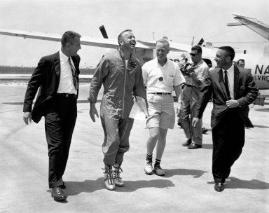 KENNEDY SPACE CENTER, FLA. - Astronauts Deke Slayton, far left, and Virgil Grissom, far right, were on hand to greet Astronaut Alan B. Shepard at Grand Bahama Island after his historic first U.S. manned suborbital flight. Just behind Astronaut Shepard is Dr. Keith Lyndell.