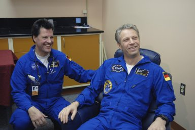 KENNEDY SPACE CENTER, FLA. -- European Space Agency astronaut Thomas Reiter (seated), returning from a 6-month stay on the International Space Station, visits with colleagues in the crew quarters at Kennedy Space Center. Reiter returned to Earth with the STS-116 crew aboard Space Shuttle Discovery. Landing took place on Runway 15 at NASA Kennedy Space Center's Shuttle Landing Facility as the sun set on the shortest day of the year. During the STS-116 mission, three spacewalks attached the P5 integrated truss structure to the station, and completed the rewiring of the orbiting laboratory's power system. A fourth spacewalk retracted a stubborn solar array. Main gear touchdown was at 5:32 p.m. EST. Nose gear touchdown was at 5:32:12 p.m. and wheel stop was at 5:32:52 p.m. At touchdown -- nominally about 2,500 ft. beyond the runway threshold -- the orbiter is traveling at a speed ranging from 213 to 226 mph. Discovery traveled 5,330,000 miles, landing on orbit 204. Mission elapsed time was 12 days, 20 hours, 44 minutes and 16 seconds. This is the 64th landing at KSC. Photo credit: NASA/Kim Shiflett
