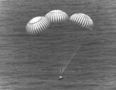 KENNEDY SPACE CENTER, FLA. -- The three main parachutes lower the ASTP Apollo Command Module into the Pacific Ocean west of Hawaii. The splashdown at 5:18 p.m. ended the nine-day mission for ASTP astronauts Thomas Stafford, Vance Brand and Donald Slayton. The Apollo was picked up by the USS New Orleans after which the crewmen participated in ceremonies on the ship's deck.