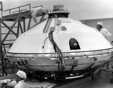 KENNEDY SPACE CENTER, FLA. -- Technicians prepared for removal of Viking Lander 1's aeroshell cover in KSC's Spacecraft Assembly and Encapsulation Facility 2 (SAEF-2) today. The cover remains over the Lander throughout its 440,000,000-mile journey to Mars. After the Lander separates from the Orbiter, the aeroshell will help to decelerate the speed of descent and will serve as a heat shield. After the aeroshell separates, the Lander's parachute will deploy at about 4,000 feet altitude to further slow descent for a soft landing on the Red Planet. The Kennedy Space Center will launch the first Viking from Complex 41, Cape Canaveral, no earlier than Aug. 11. The second Viking will be launched no earlier than Aug. 21.
