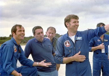 """KENNEDY SPACE CENTER, FLA. - Astronaut Robert Crippen, left, relaxed despite the """"scrub"""" of the Space Shuttle launch on April 10, is joined at the Shuttle Landing Facility on April 11 by (from left) George Abbey, flight operations director; Joseph Algrantic, chief of Aircraft OPERATIONS Division, both with Johnson Space Center; and astronaut Joe Engle. Crippen and Young spent part of the day between the """"scrub"""" and the successful launch on April 12 in Shuttle landing practice, using a specially modified Grumman Airstream jet aircraft."""