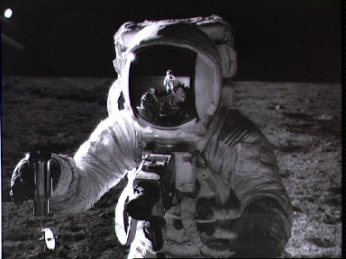 Astronaut Alan Bean holds Special Environmental Sample Container