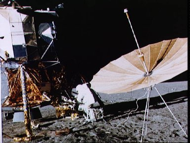 Astronaut Charles Conrad stands at Modular Equipment Stowage Assemble