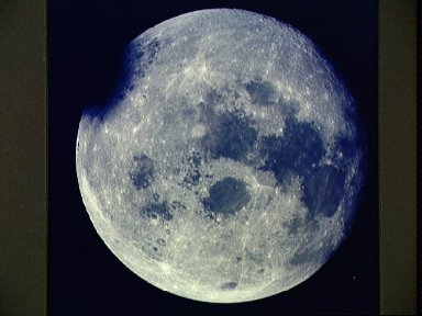 View of near full Moon photographed by Apollo 13 during transearth journey
