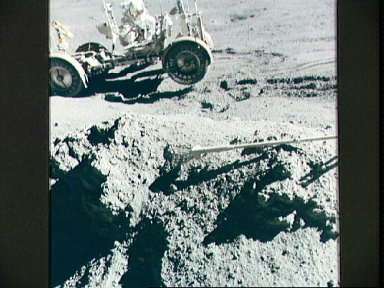 Astronaut James Irwin keeps Lunar Roving Vehicle from sliding downhill