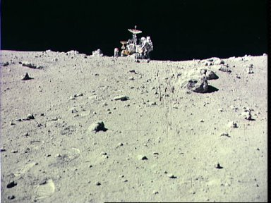 Astronaut Charles Duke works at front of Lunar Roving Vehicle