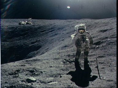 Astronaut Charles Duke photographed collecting lunar samples at Station 1