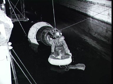 Astronaut John Glenn during egress training activity at Langley