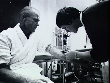 Astronaut John Glenn has blood drawn during training