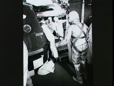 Astronauts Alan Shepard in pressure suit approaches Freedom 7 capsule