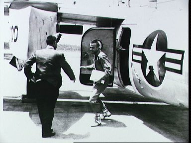 Astronaut Shepard arrives at Grand Bahamas Island and is greeted by Grissom