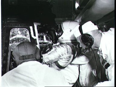 Astronaut Grissom climbs into Liberty Bell 7 capsule to begin MR-4 mission