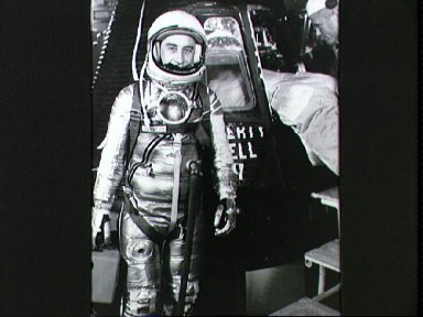 Astronaut Grissom on level 3 in front of Liberty Bell 7 capsule